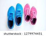 pair of blue running sneakers... | Shutterstock . vector #1279974451