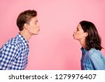 Stock photo profile side view portrait of nice sweet charming adorable lovely attractive flirty couple reaching 1279976407
