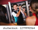bartender shaking cocktail in... | Shutterstock . vector #1279990564