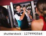 bartender shaking cocktail in... | Shutterstock . vector #1279990564