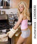 pretty blond baking a pie in... | Shutterstock . vector #12800830