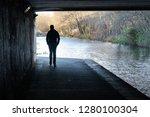 Silhouette Of A Man Walking...