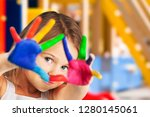 cute little girl with painted... | Shutterstock . vector #1280145061