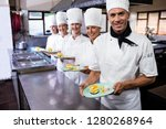 group of chefs holding plate of ... | Shutterstock . vector #1280268964