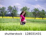 beautiful young pregnant woman... | Shutterstock . vector #128031431