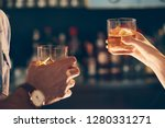 a man and a woman toasting with ... | Shutterstock . vector #1280331271
