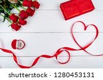 red ribbon shaped as heart ... | Shutterstock . vector #1280453131