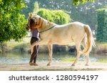 purebred arabian horse hugging... | Shutterstock . vector #1280594197