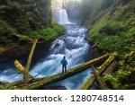 Man Standing By A Koosah Falls  ...