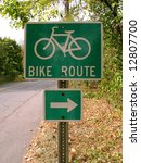 A Green Bike Route Sign On The...