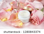 Cream Cosmetic And Roses Petal...