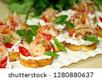 bruschetta with shrimps and... | Shutterstock . vector #1280880637