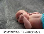 close up on newborn baby on the ... | Shutterstock . vector #1280919271