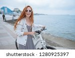 beautiful woman riding on bike. ... | Shutterstock . vector #1280925397