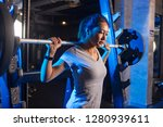 woman in gym lifting weights on ... | Shutterstock . vector #1280939611