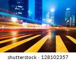 the light trails on the modern...   Shutterstock . vector #128102357