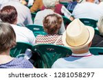 back view of people watching an ... | Shutterstock . vector #1281058297