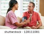 nurse visiting senior male... | Shutterstock . vector #128111081