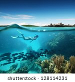 young woman snorkeling in the... | Shutterstock . vector #128114231