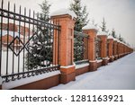 metal fence made of bricks.... | Shutterstock . vector #1281163921