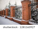 metal fence made of bricks.... | Shutterstock . vector #1281163927