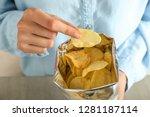 woman eating tasty potato chips ...   Shutterstock . vector #1281187114