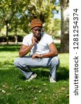 athletic young male in  hat... | Shutterstock . vector #1281254374