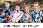 ordinary children in the park... | Shutterstock . vector #1281283324