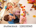 child painting in kindergarten...   Shutterstock . vector #128133365