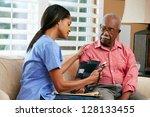 nurse visiting senior male...   Shutterstock . vector #128133455