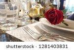 red rose flower on table in... | Shutterstock . vector #1281403831