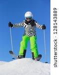Girl with ski on the mountain - stock photo