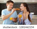 man and woman in the kitchen... | Shutterstock . vector #1281462154