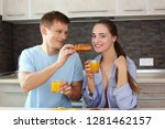 man and woman in the kitchen... | Shutterstock . vector #1281462157
