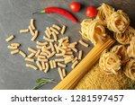 assortment of uncooked pasta on ...   Shutterstock . vector #1281597457
