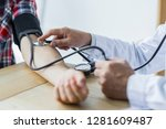cropped image of male doctor...   Shutterstock . vector #1281609487
