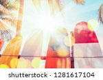 surfboard and palm tree on... | Shutterstock . vector #1281617104