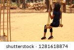 a girl enjoying swing in a park ... | Shutterstock . vector #1281618874