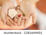 Stock photo heart shape home key with house keyring and mini heart figure on kid s hand to giving sweet 1281644401