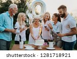family celebrating a  60th... | Shutterstock . vector #1281718921