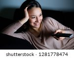 girl with television remote... | Shutterstock . vector #1281778474
