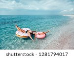 mom with child chilling on lilo ... | Shutterstock . vector #1281794017