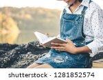 women in winter sit read... | Shutterstock . vector #1281852574