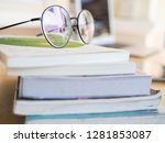 eyes glasses on books in room... | Shutterstock . vector #1281853087