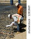 foreman checks rebar cage for...   Shutterstock . vector #1281869