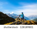 mountain biking   woman on bike ... | Shutterstock . vector #128189801