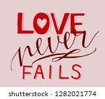 hand lettering love never fails ... | Shutterstock .eps vector #1282021774