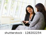 businesswomen with digital... | Shutterstock . vector #128202254