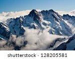 Snowy Alpen Peaks Above Clouds