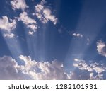 radiating sunbeams and white...   Shutterstock . vector #1282101931